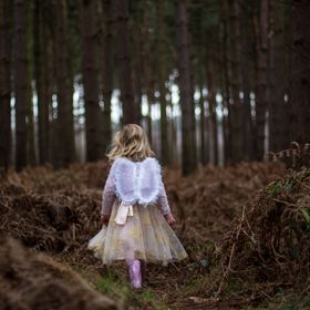 During a photo shoot, this young girl had no fear of exploring the dark areas of Woodland, completely candid and enchanting.