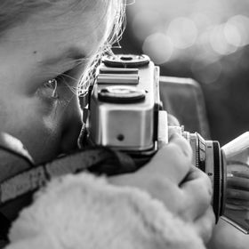 A little girl playing with one of my Vintage Camera's.