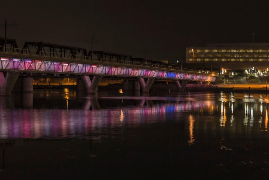 The lit up bridge in Tempe, AZ