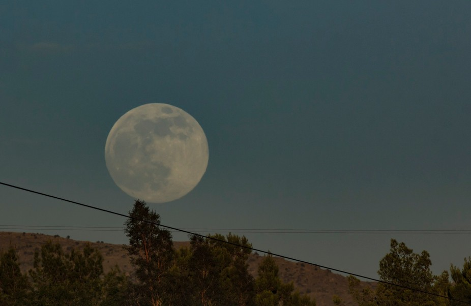 "The ""Super Moon"" rises over the Rincon ridge near Tucson, AZ"
