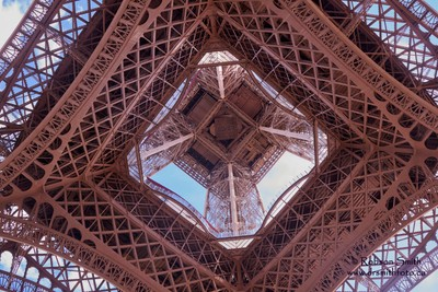 Worm's eye view of the iconic Eiffel Tower - Photo by Robson Smith