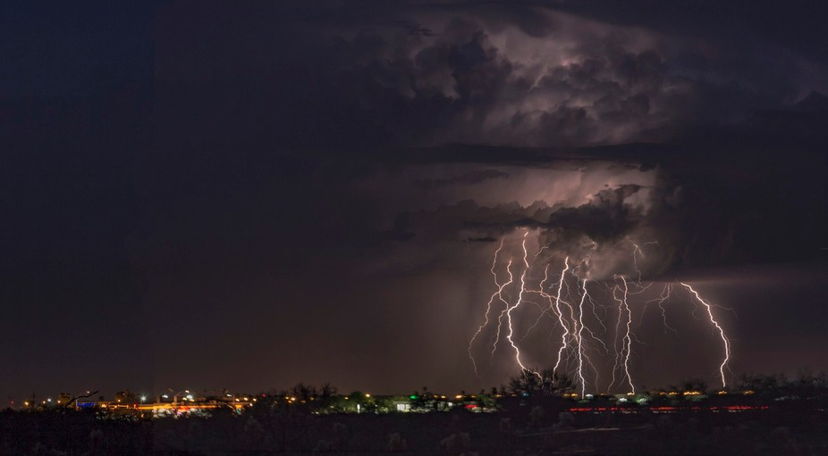 The lightning strikes look to be dancing towards the city.