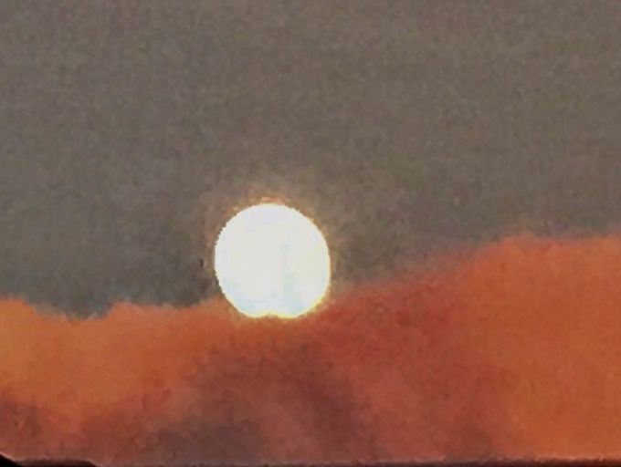 Such dark clouds, so bright a moon!