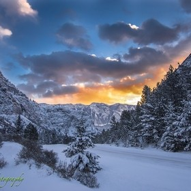 the snow in the mountains and sunset