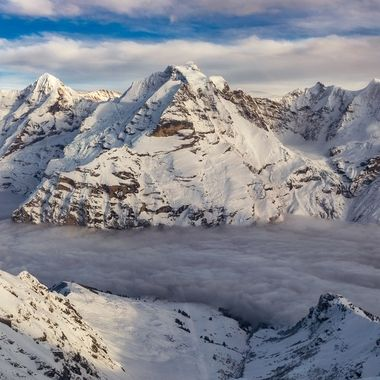 Clouds setting in the valley as the sun Beginning to Set at Schilthorn near Interlaken, Switzerland