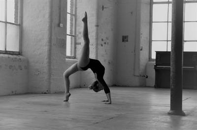 Back bend and raised leg yoga pose