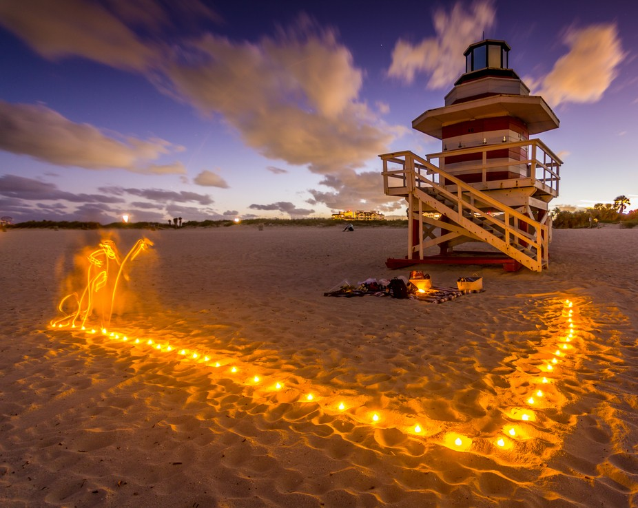 Meditation Group sets up lights by lifeguard shack at South Beach in Miami Beach, Florida.