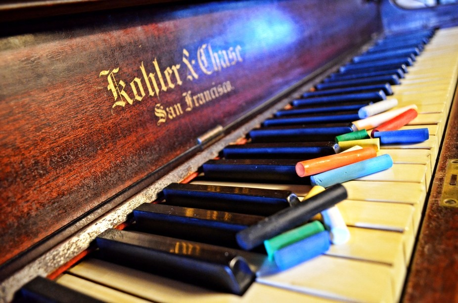 Pastels on the keys of my grand piano.