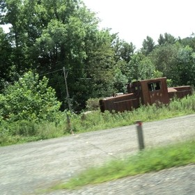 In our way to the Blue Mountains in N.C. I saw a junk vehicle cemetery. I wished to jump out of the car to get closer shots, specially of the one...