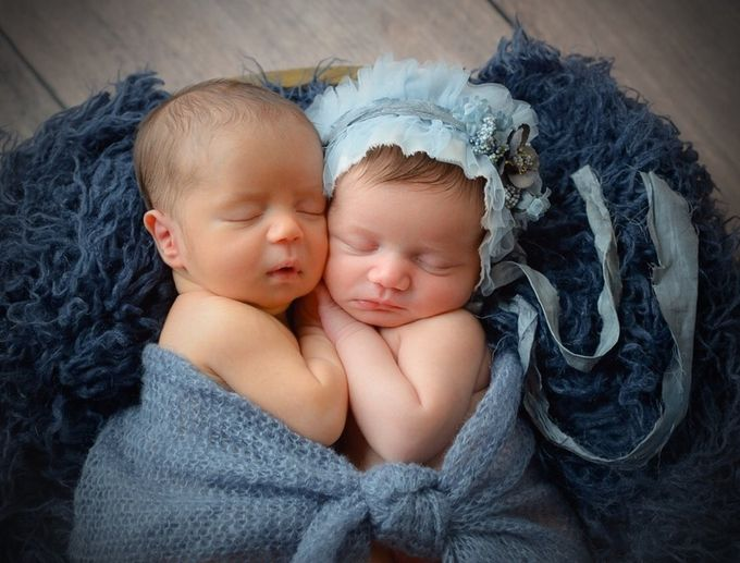 Two in Blue..... these two little ones rocked snuggly time.  by Emily13 - Babies Are Cute Photo Contest