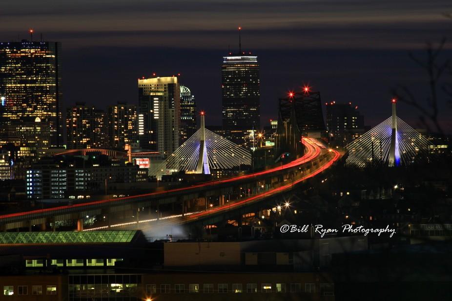 A different look at Boston's Leonard P. Zakim Bridge, the City of Boston and night time ...