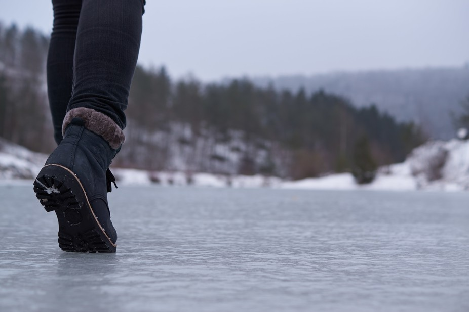 I was walking on a frozen lake with my friend