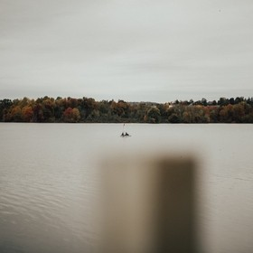 Overcast on the lake, I spotted these two rowing away.