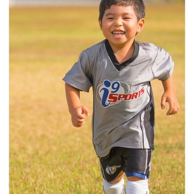 running, laughing, and oh yeah, kicking the soccer ball....   lol