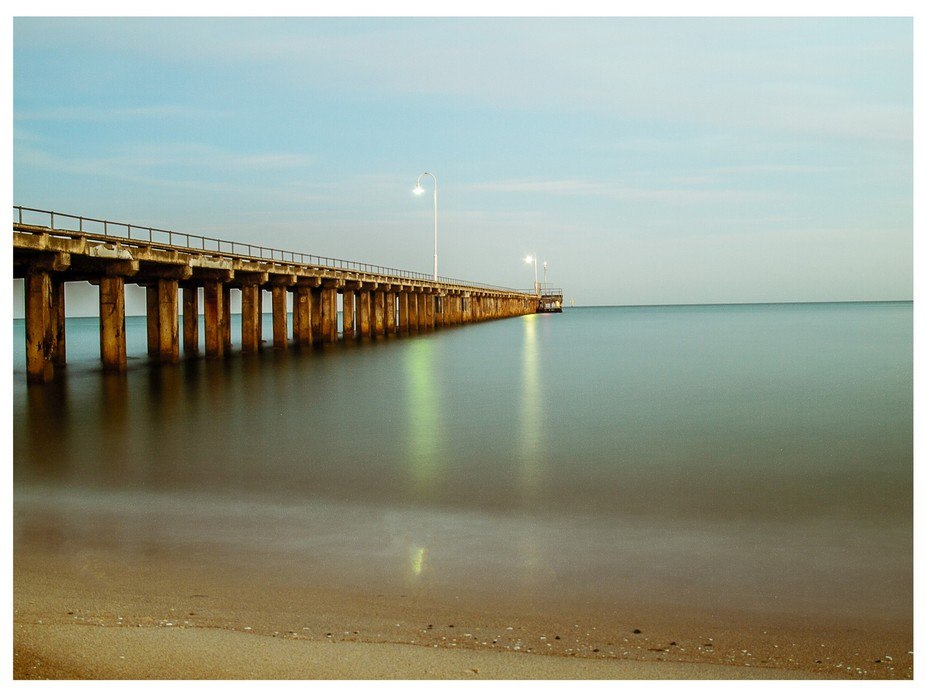 First light over the sea on Port Phillip Bay and a very long exposure