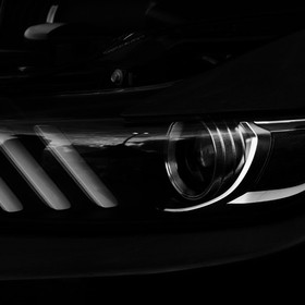 Natural and Studio Lights mixing.  Front Headlight of a Mighty Mustang