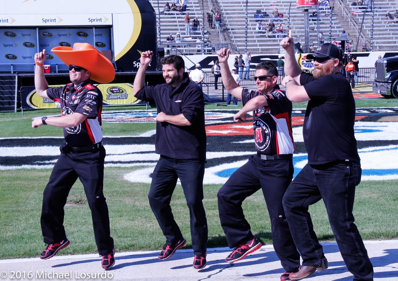 Nascar crew doing a dance