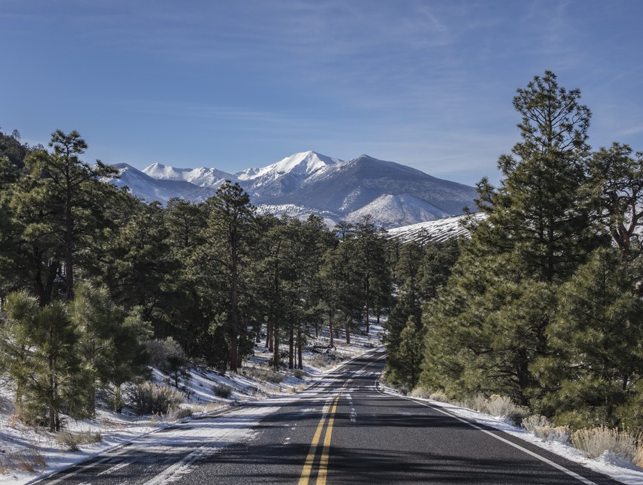 Winter road to snow covered landscape in color