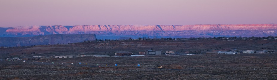 The plateau backdrop over Page Arizona at winter sunset gets lit in colors.