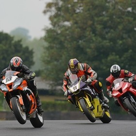 You wait ages for one bike racer to pull a wheelie, then three turn up at once: the Kawasakis of Mathew Waldon and Nick Williamson sandwich Chris...