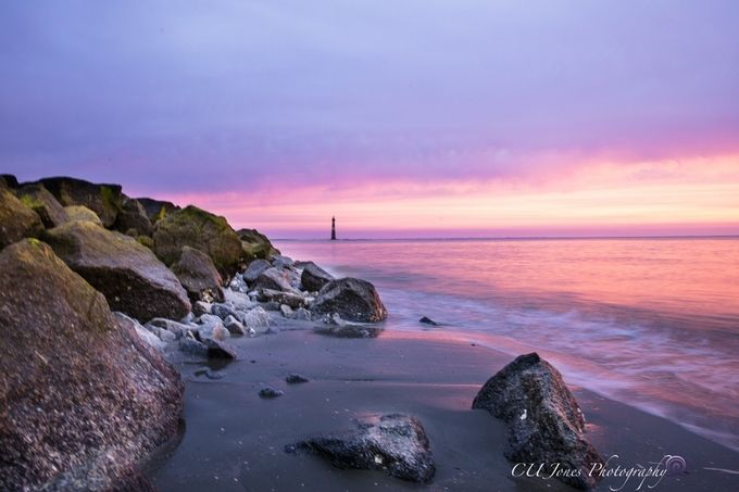 Folly Beach, South Carolina the Morris Island end of the beach. The sunrise was very red this morning. Taken on 02-18-2017 the low tide and sunrise happens at the same time.