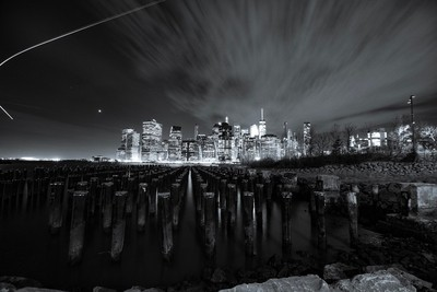 Manhattan from Brooklyn Bridge Park.  A helicopter light adds a very cool trail.  30sec, iso 100, f11, Canon 5D mark iv