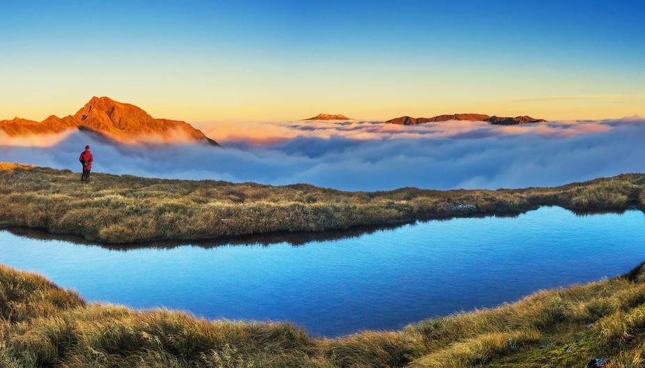 Dawn view on the saddle (1,600m) beneath Tiraha, west to Te Hekenga (1,695m - left), Mount Ruapeh...