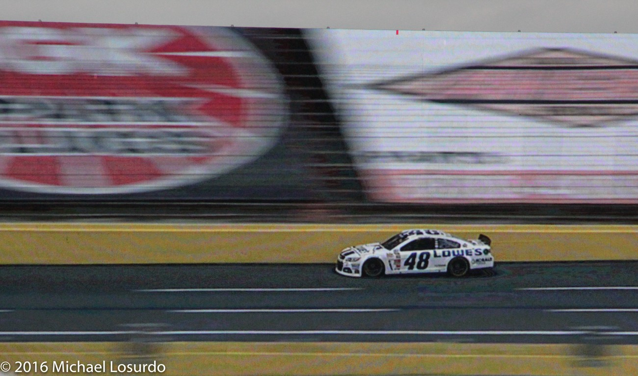 Catching the 48 car and panning the camera.  The car is sharp focus the rest has a blur.