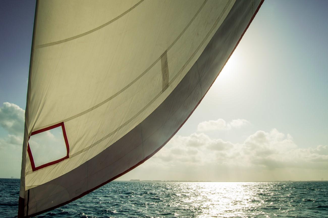 A view of a catamaran sail and the Caribbean sea