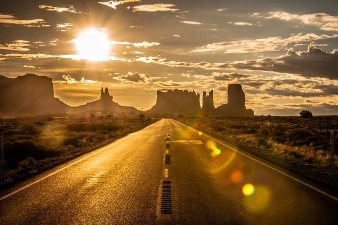 Leaving Monument Valley and heading north, looking back down the road, Monument Valley, Navajo Nation, USA by scottsinclair - Summer Road Trip Photo Contest