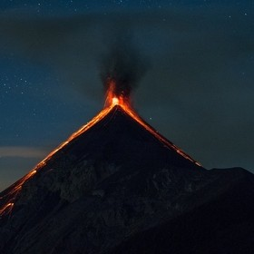 Volcano de fuego erupting, seen from the basecamp of Acatenango in Guatemala