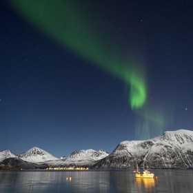 Northern lights over a bay in Tromso