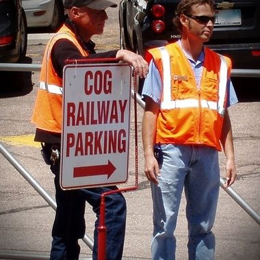 My husband and his manager working as parking lot attendants at the COG Railway in Manitou, Colorado.
