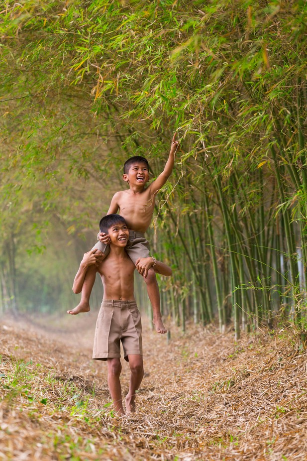 Strolling in Bamboo Forest by Duangmon - Children In Nature Photo Contest