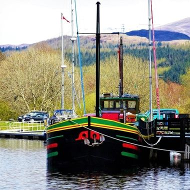 Colourful Boat on canal locks Fort Augustus in early Spring