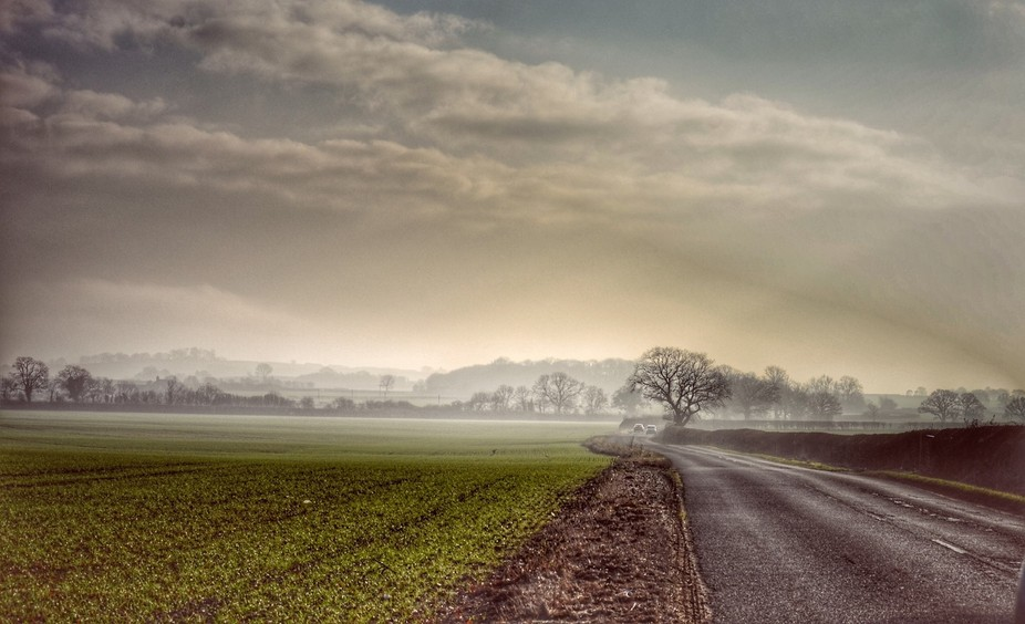 This is the mad mile, a strip of road loved by bikers for the straights, it looks into Tamworth t...