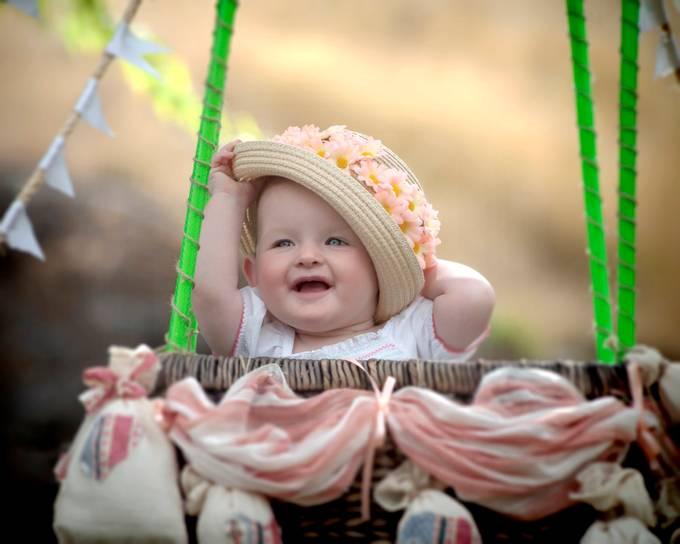 Little Harper enjoying her photo shoot in a magical balloon.