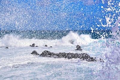 Waves crashing on the lens