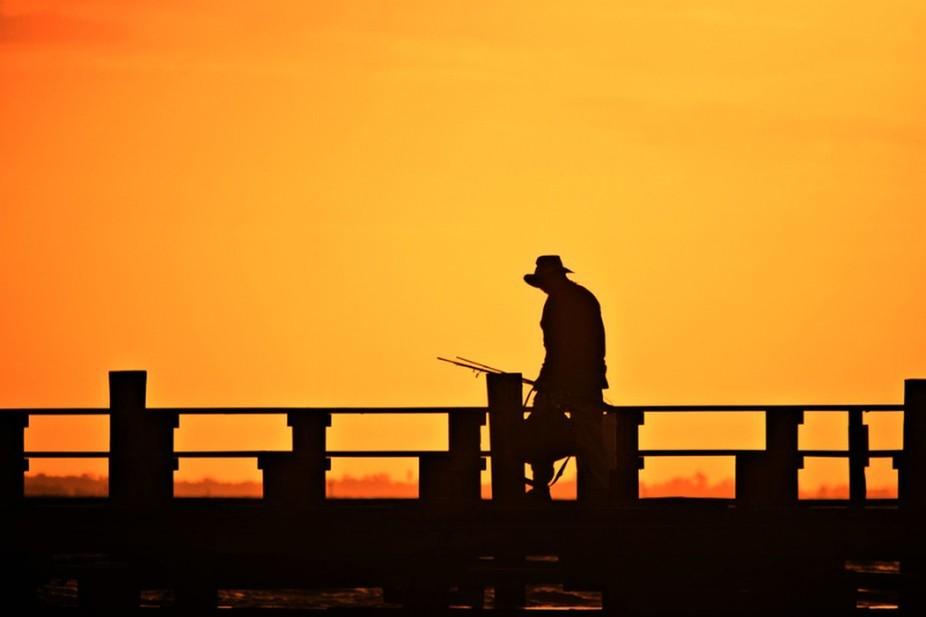 Early Fisherman in silhouette