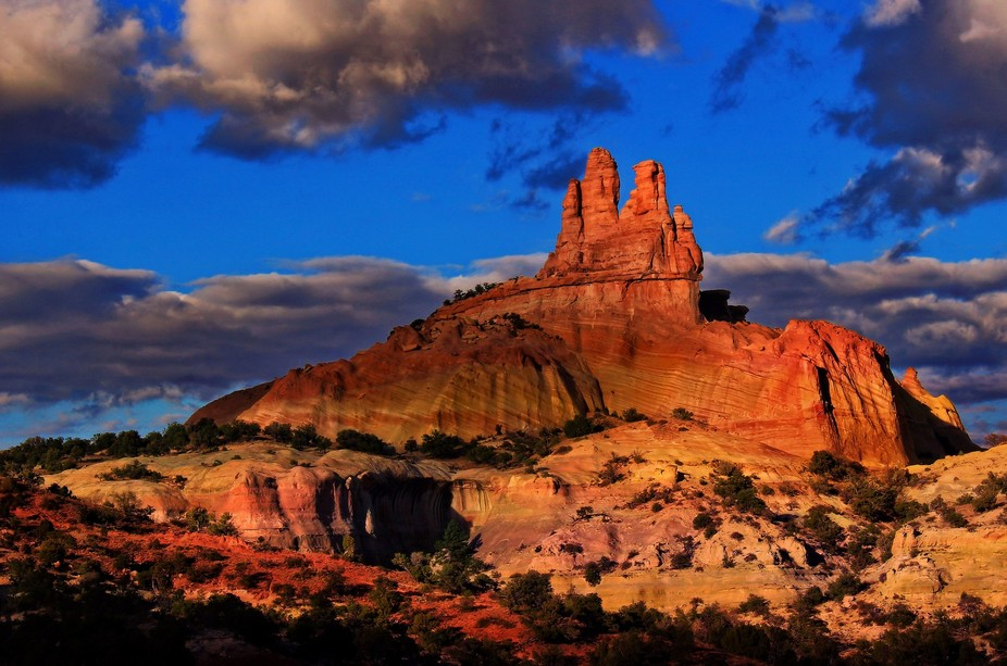 Church Rock in a cascade of light between shadows from clouds in the evening sky.  My Brother and...