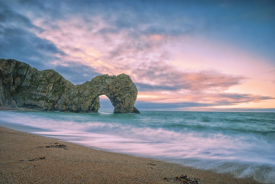 The early morning sky at Durdle Door on the south coast of England.