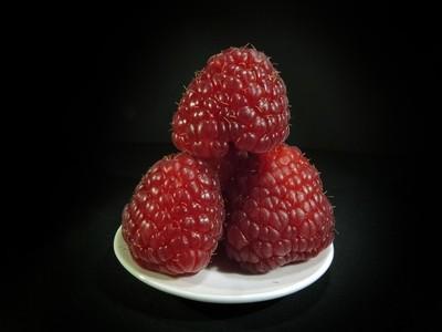 Raspberries on a white plate