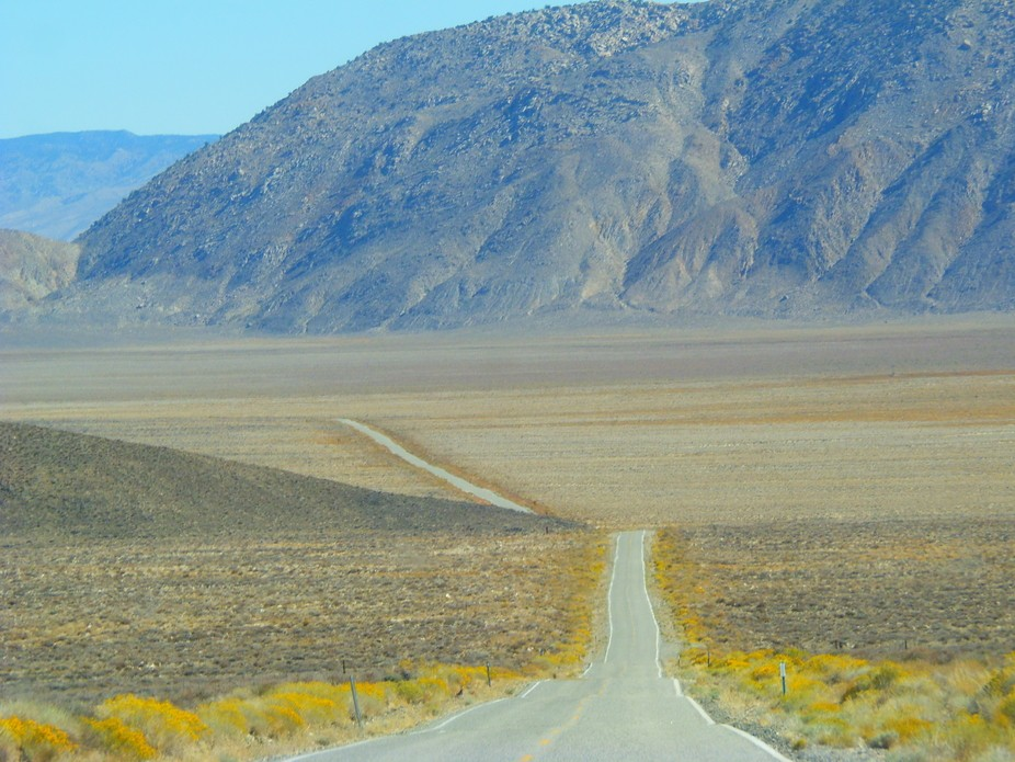 Shot driving through Death Valley Nevada on a hot, hazy summer day.