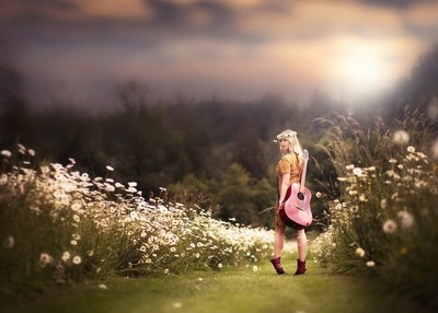 Girl with Guitar in a Daisy Field
