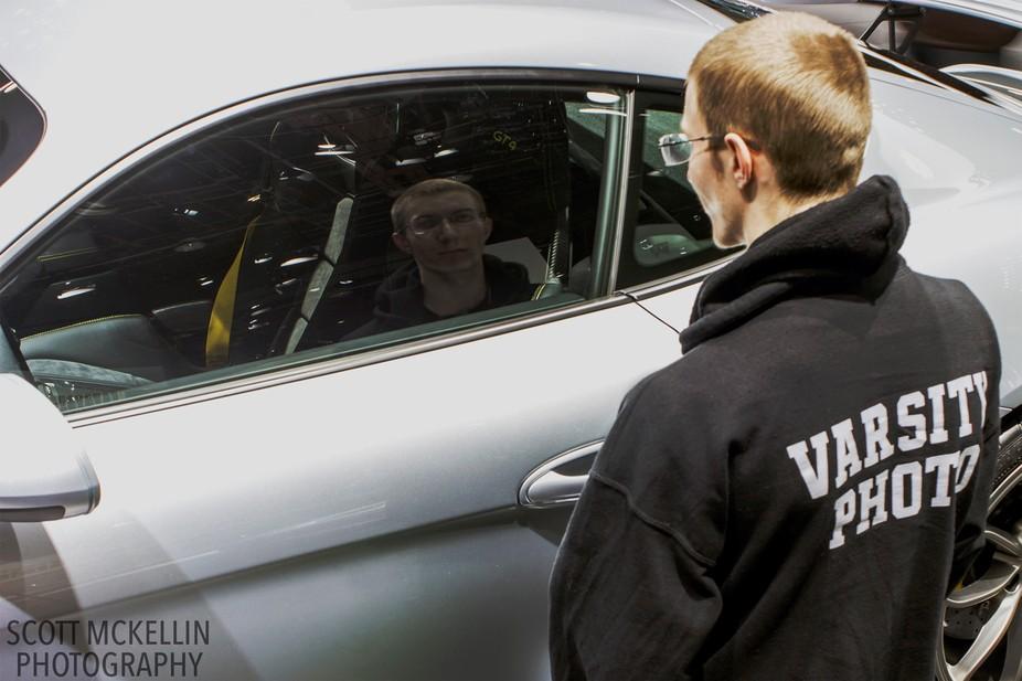 Self-portrait via Porsche Window