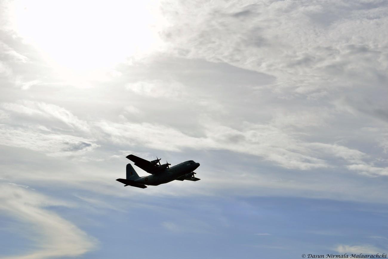 Lockheed C-130 Hercules reaching the clouds.
