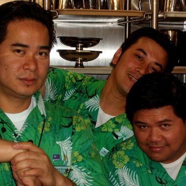 Working Men in Green Hawaiian Shirts