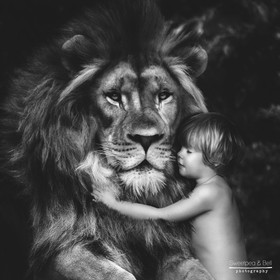 Just a boy cuddling his lovely Lion
