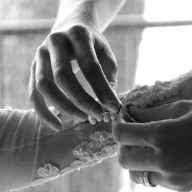 My first wedding photo shoot and I just loved this one shot of the brides sister helping her button these tiny buttons on the sleeves.