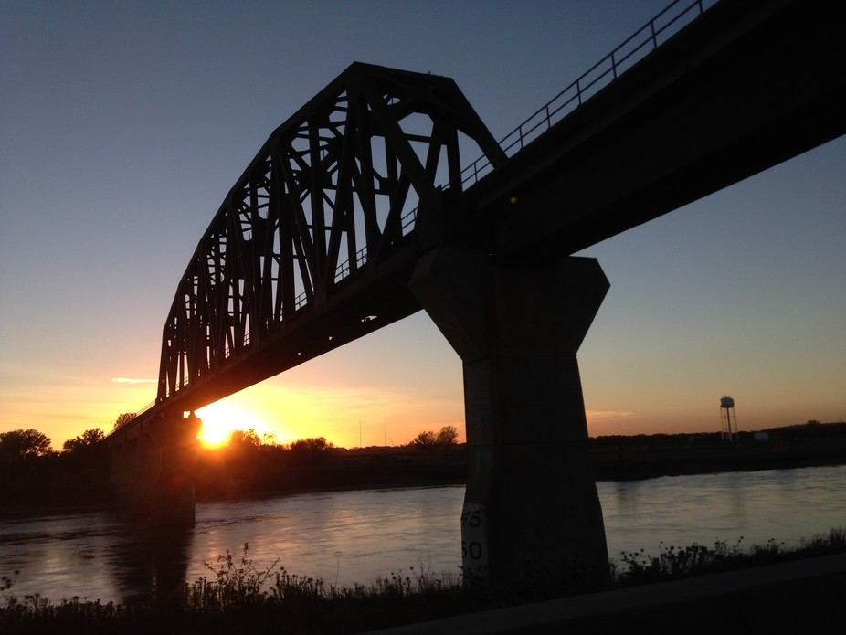 This is the train bridge connecting Iowa and Nebraska where I live. I love driving under it, espe...
